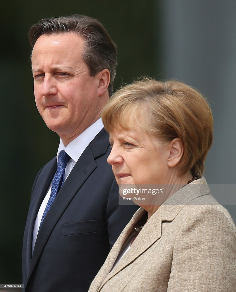German Chancellor Angela Merkel and British Prime Minister David Cameron listen to their nations' national anthems upon Cameron's arrival at the Chancellery on May 29, 2015 in Berlin, Germany. Cameron is in Berlin as part of his tour of European Union member states capitals in order to persuade leaders on the necessity of E.U. reforms.