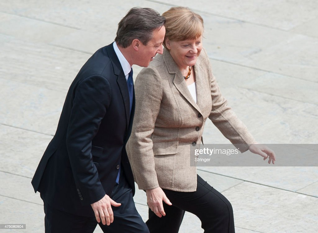 German Chancellor Angela Merkel and British Prime Minister David Cameron prepare to listen to their nations' national anthems upon Cameron's arrival at the Chancellery on May 29, 2015 in Berlin, Germany. Cameron is in Berlin as part of his tour of European Union member states capitals in order to persuade leaders on the necessity of E.U. reforms.