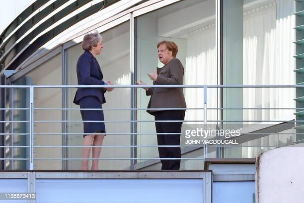 TOPSHOT German Chancellor Angela Merkel and British Prime Minister Theresa May speak on the terrasse at the Chancellery in Berlin on April 9 2019...