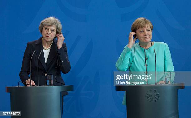 German Chancellor Angela Merkel and British Prime Minister Theresa May speak to the media following talks at the Chancellery on July 20, 2016 in...