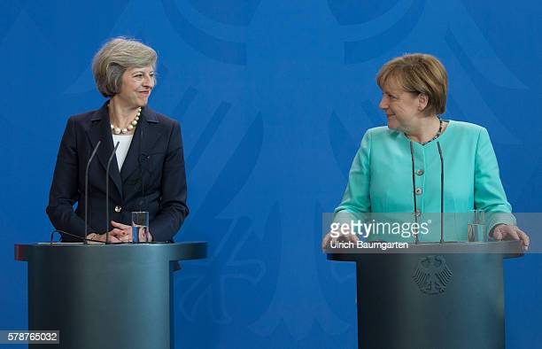 German Chancellor Angela Merkel and British Prime Minister Theresa May speak to the media following talks at the Chancellery on July 20 2016 in Berlin