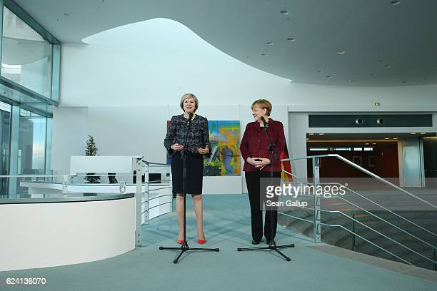 German Chancellor Angela Merkel and British Prime Minister Theresa May give statements to the media prior to bilateral talks as the Reichstag is...