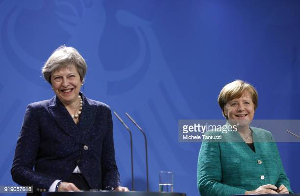 German Chancellor Angela Merkel and British Prime Minister Theresa May react as they speak to the media following talks between the two leaders at...