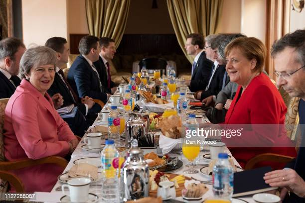 German Chancellor Angela Merkel and British Prime Minster Theresa May hold bilateral talks over breakfast during the first ArabEuropean Summit on...