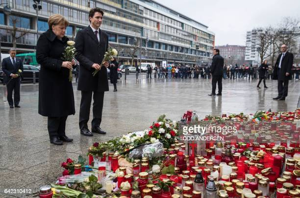 German Chancellor Angela Merkel and Canadian prime minister Justin Trudeau place flowers at a memorial to the victims of the Breitscheidplatz...