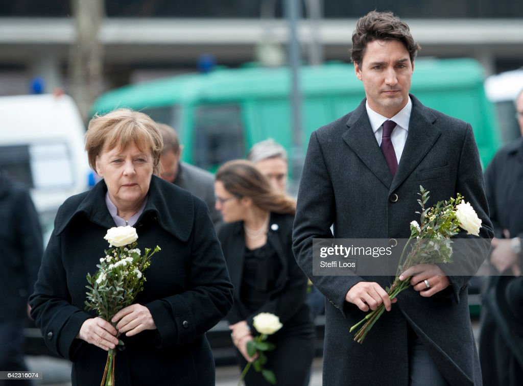 German Chancellor Angela Merkel and Canadian Prime Minister Justin Trudeau prepare to lay flowers at a memorial to the victims of the December Berlin terror attack at Breitscheidplatz on February 17, 2017 in Berlin, Germany. Canada's Prime Minister Justin Trudeau is visiting Germany for his first official visit after delivering a speech during a plenary session at the European Parliament in Strasbourg, France consisting of a pro-trade pitch to a conflicted Europe. On December 19 Anis Amri, a Tunisian man who had sought asylum in Germany, drove a truck into the crowded Christmas market at Breitscheidplatz and killed 12 people.
