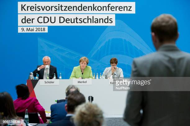German Chancellor Angela Merkel and CDU Secretary General Annegret KrampKarrenbauer listen to a question of a CDU member during a District chairwowen...