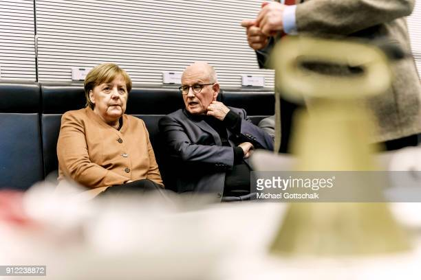 German Chancellor Angela Merkel and CDU/CSU faction leader Volker Kauder attend the meeting of CDU/CSU party faction on January 30 2018 in Berlin...