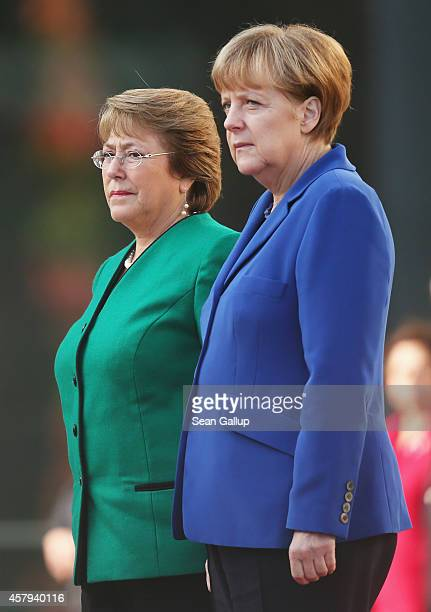 German Chancellor Angela Merkel and Chilean President Michelle Bachelet review a guard of honour upon Bachelet's arrival at the Chancellery on...