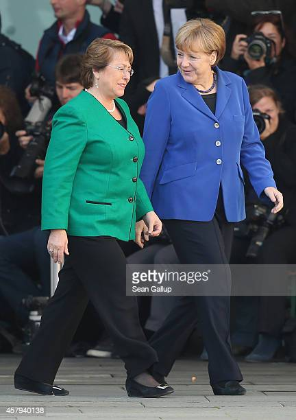 German Chancellor Angela Merkel and Chilean President Michelle Bachelet chat upon Bachelet's arrival at the Chancellery on October 27 2014 in Berlin...