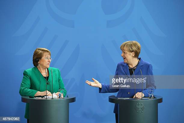 German Chancellor Angela Merkel and Chilean President Michelle Bachelet speak to the media follwing talks at the Chancellery on October 27 2014 in...
