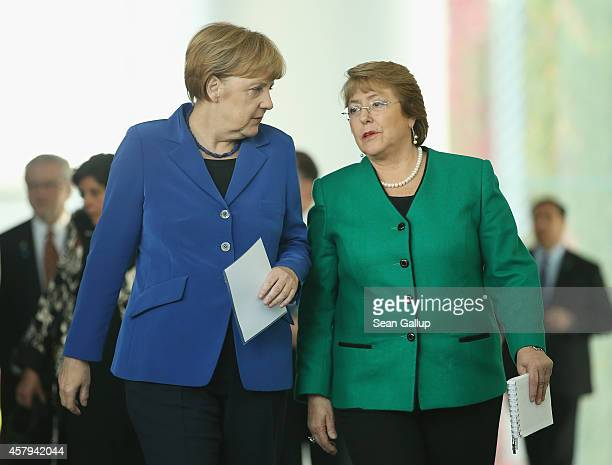 German Chancellor Angela Merkel and Chilean President Michelle Bachelet arrive to speak to the media follwing talks at the Chancellery on October 27...