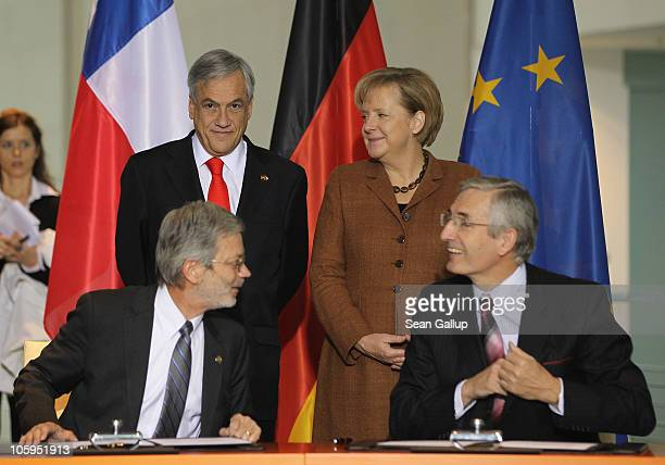 German Chancellor Angela Merkel and Chilean President Sebastian Pinera look on as Chilean Economy Minister Juan Andres Fontaine and Fraunhofer...