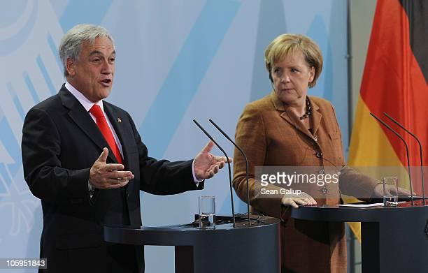 German Chancellor Angela Merkel and Chilean President Sebastian Pinera speak to the media following bilateral talks at the Chancellery on October 22...