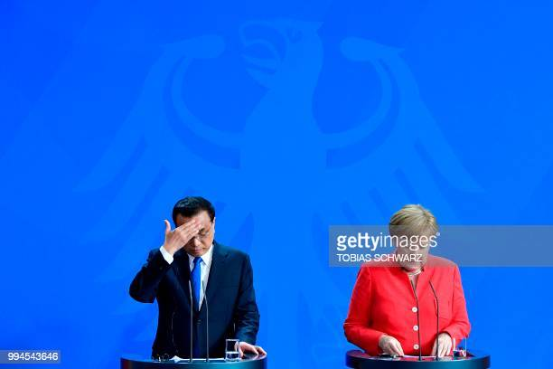 German Chancellor Angela Merkel and Chinese Premier Li Keqiang attend a press conference at the Chancellery in Berlin on July 9 2018 German...