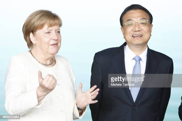 German Chancellor Angela Merkel and Chinese Premier Li Keqiang attend an event to present a project on autonomous driving at former Tempelhof airport...