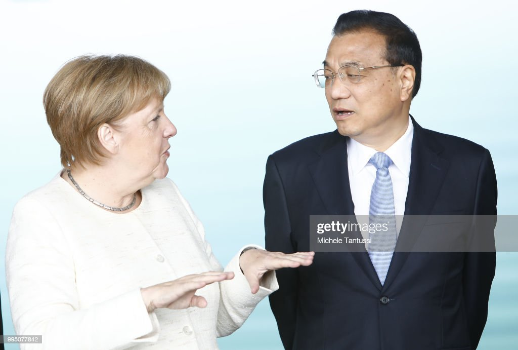 Merkel And Li Attend Autonomous Driving Event