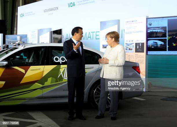 German Chancellor Angela Merkel and Chinese Premier Li Keqiang attend a presentation on autonomous driving at the Tempelhof Airport in Berlin Germany...