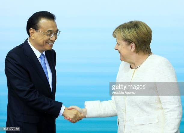 German Chancellor Angela Merkel and Chinese Premier Li Keqiang hold a press conference following a presentation on autonomous driving at the...
