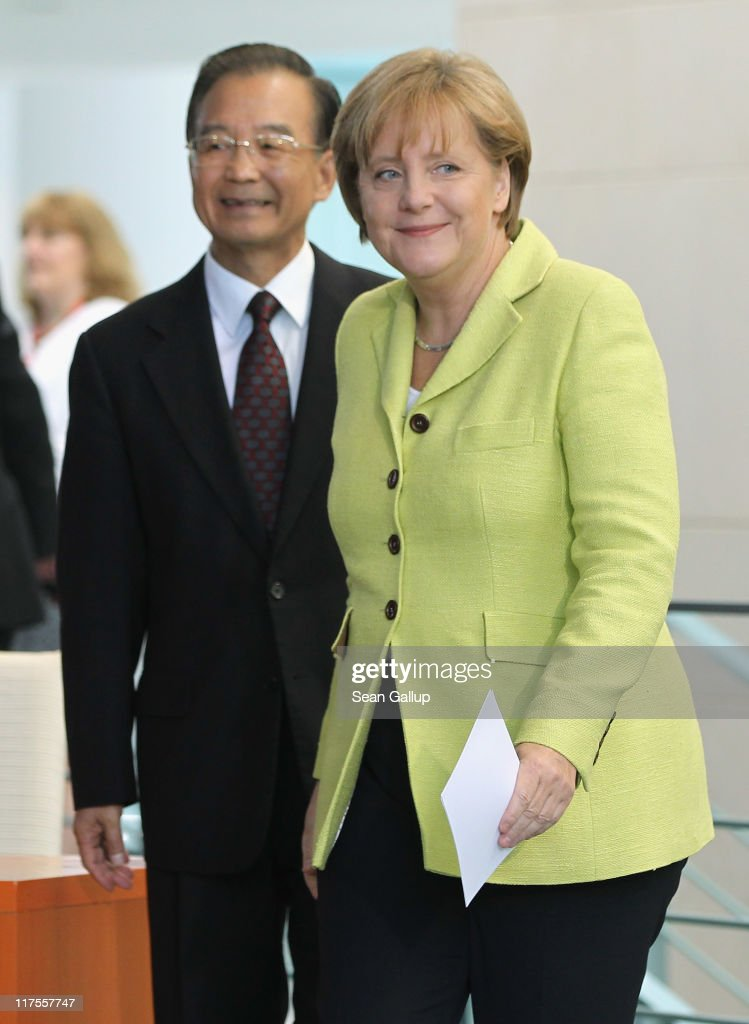 German Chancellor Angela Merkel and Chinese Premier Wen Jiabao arrive to speak to the media at the Chancellery on June 28, 2011 in Berlin, Germany. The Chinese leader is visiting a variety of European countries and in Germany is participating in the first-ever German-Chinese government consultations.