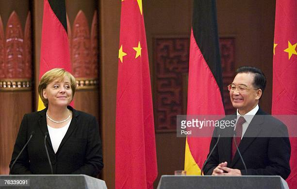 German Chancellor Angela Merkel and Chinese Premier Wen Jiabao hold a joint press conference after a meeting at the Great Hall of the People on...