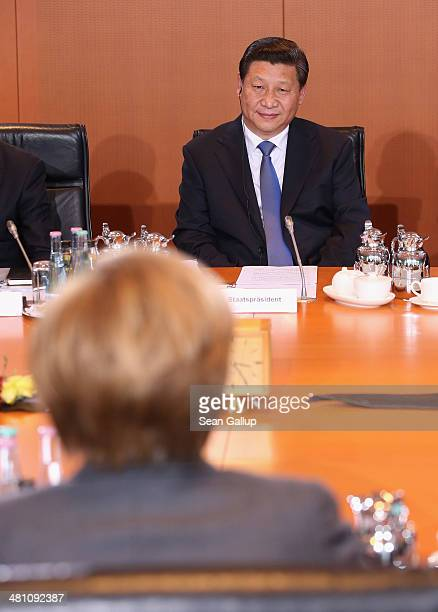 German Chancellor Angela Merkel and Chinese President Xi Jinping face one another during German-Chinese government talks at the Chancellery on March...