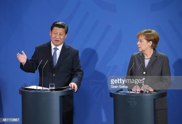 German Chancellor Angela Merkel and Chinese President Xi Jinping speak to the media following talks at the signing of bilateral agreements at the...