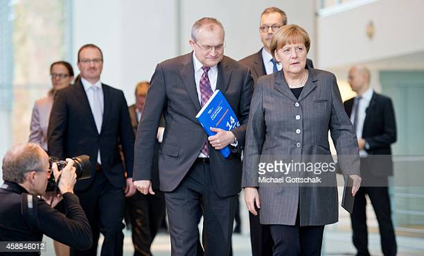 German Chancellor Angela Merkel and Christoph M. Schmidt, President of Rheinisch-Westfaelisches Instituts fuer Wirtschaftsforschung, arrive for the...