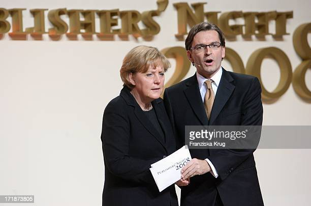 German Chancellor Angela Merkel and Claus Strunz at the Publishers Night of VDZ In The Capital Representation The Deutsche Telekom in Berlin