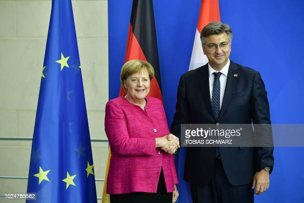 German Chancellor Angela Merkel and Croatian Prime Minister Andrej Plenkovic shake hands after a joint press conference in Berlin on August 28 2018