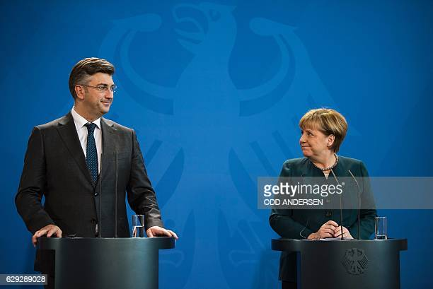 German Chancellor Angela Merkel and Croatian prime minister Andrej Plenkovic react during a press conference following a meeting at the Chancellery...