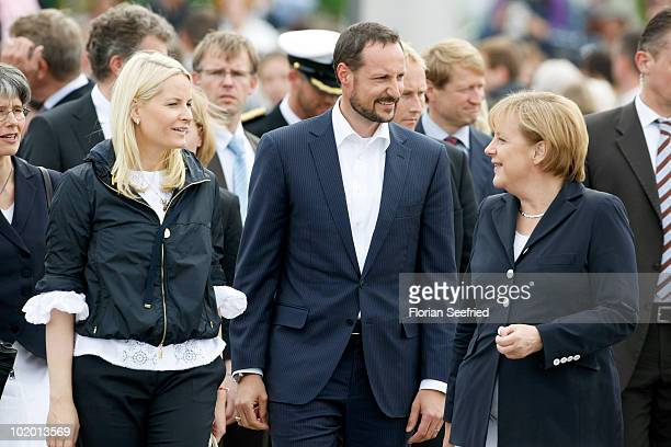 German Chancellor Angela Merkel and Crown Princess Mette-Marit of Norway and Crown Prince Haakon of Norway arrive at the Pier at Binz during their...