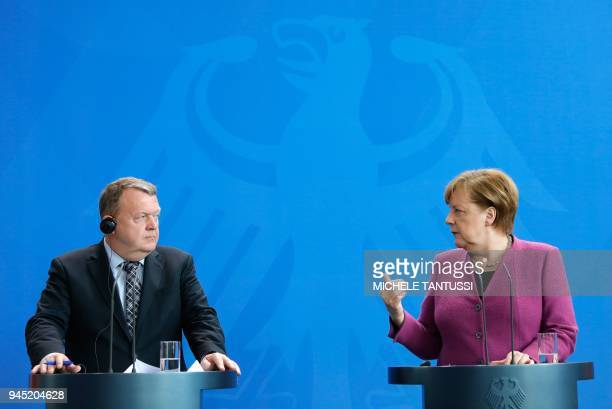 German Chancellor Angela Merkel and Danish Prime Minister Lars Lokke Rasmussen give a joint press conference on April 12, 2018 in Berlin. / AFP PHOTO...