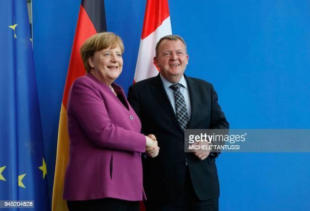 German Chancellor Angela Merkel and Danish Prime Minister Lars Lokke Rasmussen shake hands after giving a joint press conference on April 12, 2018 in...