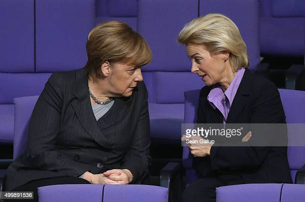 German Chancellor Angela Merkel and Defense Minister Ursula von der Leyen attend debates prior to a vote at the Bundestag on Germany's participation...