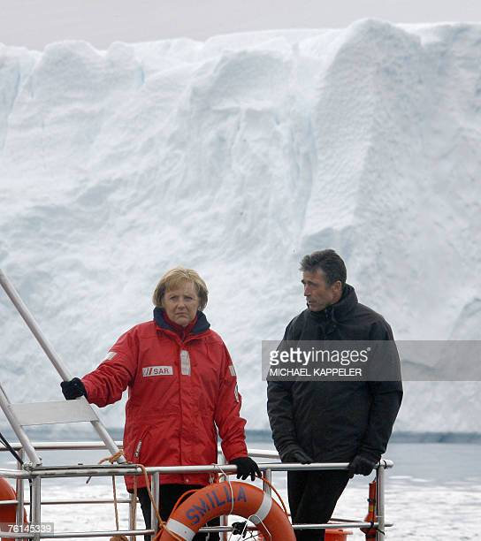 German Chancellor Angela Merkel and Denmark's Prime Minister Anders Fogh Rasmussen are pictured onboard a boat navigating through a fjord near...