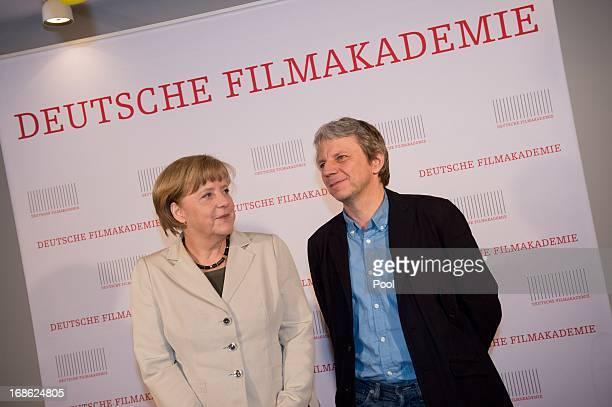 "German Chancellor Angela Merkel and director Andreas Dresen attend the screening of the 1973 film ""Die Legende von Paul und Paula"" at the Filmkunst..."