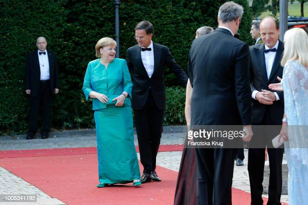German chancellor Angela Merkel and Dutch Prime Minister Mark Rutte during the opening ceremony of the Bayreuth Festival at Bayreuth Festspielhaus on...
