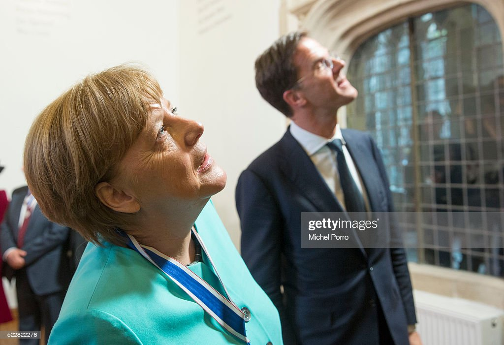 German Chancellor Angela Merkel and Dutch Prime Minister Mark Rutte take a look at the abbey interior after the Four Freedoms Awards on April 21, 2016 in Middelburg Netherlands.