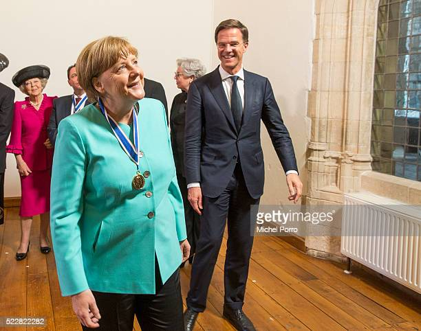 German Chancellor Angela Merkel and Dutch Prime Minister Mark Rutte take a look at the abbey interior after the Four Freedoms Awards on April 21 2016...