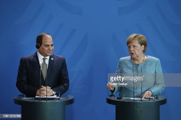 German Chancellor Angela Merkel and Egyptian President Abdel Fattah elSisi speak to the media following bilateral talks prior to the 'Compact with...
