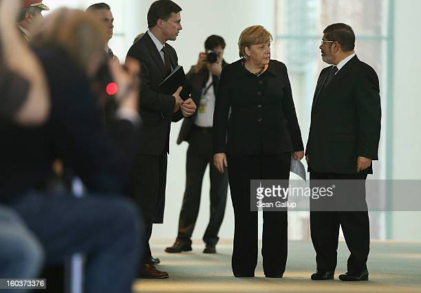 German Chancellor Angela Merkel and Egyptian President Mohamed Mursi arrive to speak to the media following talks at the Chancellery on January 30...
