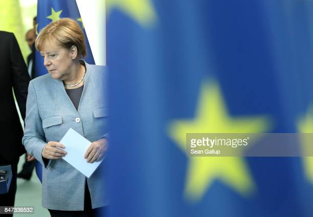 German Chancellor Angela Merkel and Emir of Qatar Sheikh Tamim bin Hamad Al Thani arrive to speak to the media following talks at the Chancellery on...