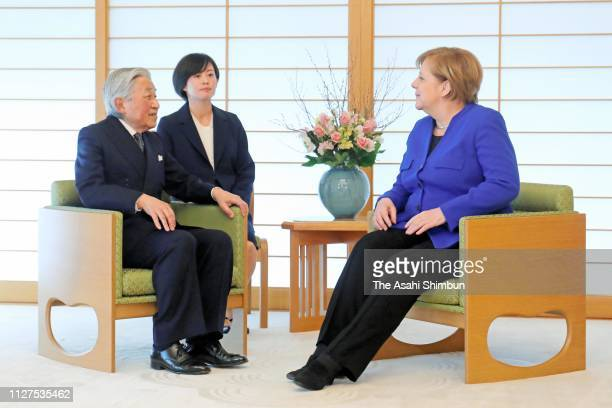 German Chancellor Angela Merkel and Emperor Hirohito talk during their meeting at the Imperial Palace on February 5, 2019 in Tokyo, Japan.