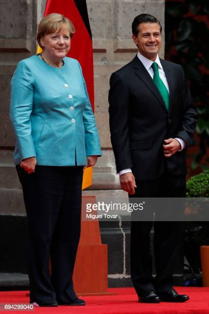 German Chancellor Angela Merkel and Enrique Pena Nieto President of Mexico pose during a reception as part of an official visit of German Chancellor...