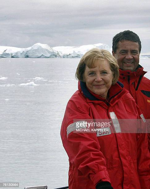German Chancellor Angela Merkel and Environment Minister Sigmar Gabriel are pictured 16 August 2007 during a round trip on a fjord near Ilulissat in...