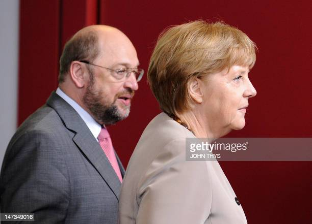 German Chancellor Angela Merkel and European Parliament President Martin Schulz arive for a family photo after a meeting of European Union leaders in...