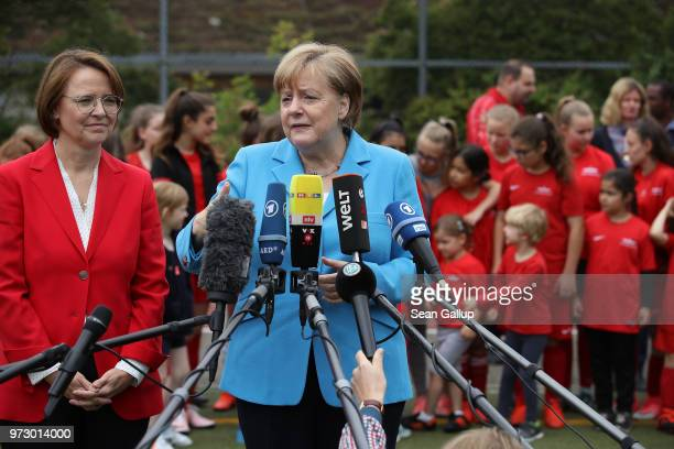 German Chancellor Angela Merkel and Federal Commissioner for Migration Refugees and Integration Annette WidmannMauz speak to the media at the...