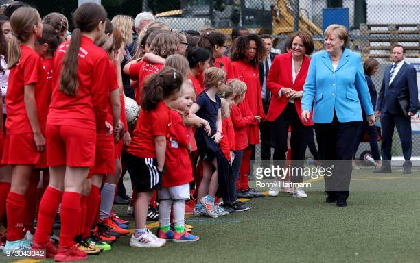 German Chancellor Angela Merkel and Federal Commissioner for Migration Refugees and Integration Annette WidmannMauz greet young girls during their...