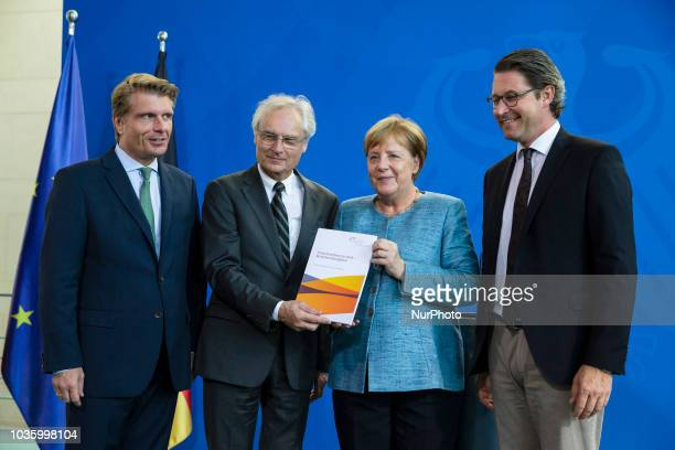 German Chancellor Angela Merkel and Federal Minister for Transport and Digital Infrastructure Andreas Scheuer receive the Development Report 2018...